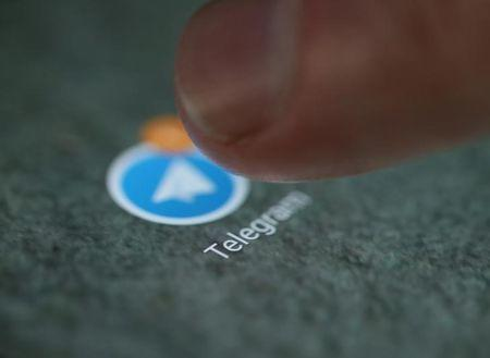 The Telegram app logo is seen on a smartphone in this illustration