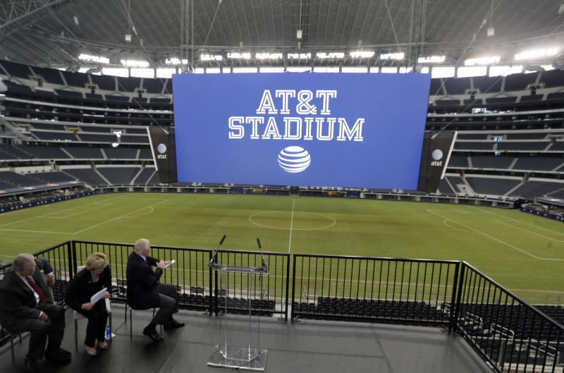The new name of Dallas Cowboys stadium is unveiled during a news conference announcing the new AT&T Stadium Thursday, July 25, 2013, in Arlington, Texas. The terms of the naming deal were not released. (AP Photo/LM Otero)