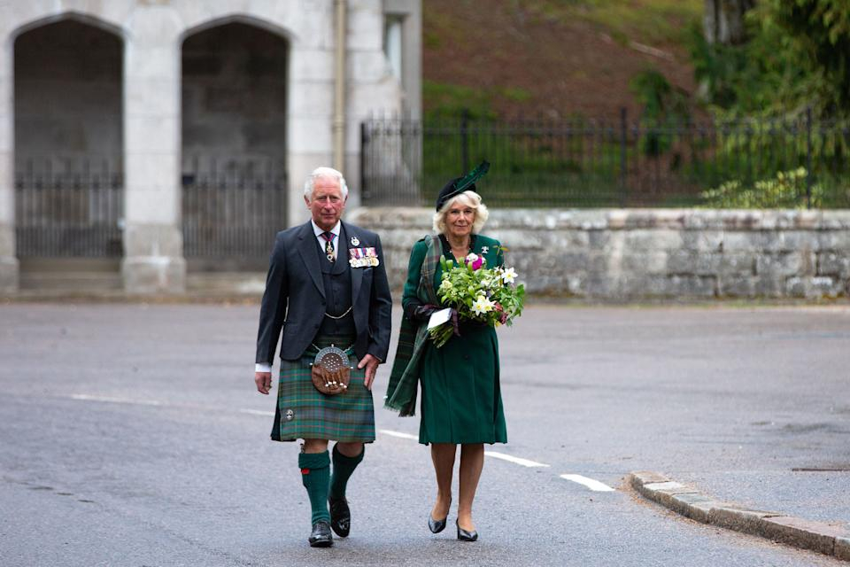 Britain's Prince Charles, Prince of Wales (L) and Britain's Camilla, Duchess of Cornwall (R) arrive to take part in a 2 minute silence to mark the 75th anniversary of VE Day (Victory in Europe Day), the end of the Second World War in Europe at the Balmoral War Memorial in central Scotland on May 8, 2020. (Photo by Amy Muir / POOL / AFP) (Photo by AMY MUIR/POOL/AFP via Getty Images)