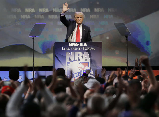 Republican presidential candidate Donald Trump waves to the crowd after speaking at the National Rifle Association convention on May 20, 2016, in Louisville, Ky. (AP Photo/Mark Humphrey)