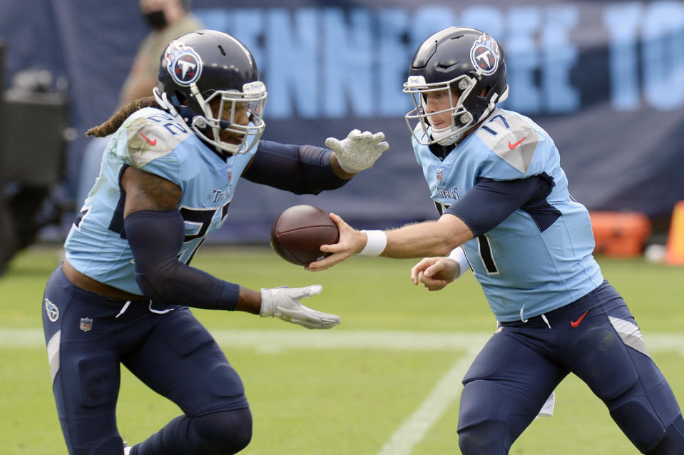 Tennessee Titans quarterback Ryan Tannehill (17) hands the ball off to running back Derrick Henry (22) in the first half of an NFL football game against the Pittsburgh Steelers Sunday, Oct. 25, 2020, in Nashville, Tenn. (AP Photo/Mark Zaleski)