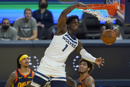 Minnesota Timberwolves guard Anthony Edwards (1) dunks against the Golden State Warriors during the first half of an NBA basketball game in San Francisco, Monday, Jan. 25, 2021. (AP Photo/Jeff Chiu)