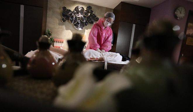 Staff at the city's bathhouses and spas will wear full protective gear while carrying out treatments. Photo: May Tse