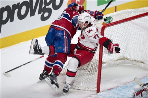 Carolina Hurricanes' Tim Brent is checked into the net by Montreal Canadiens defenseman P.K. Subban during second period NHL hockey action Monday, April 1, 2013 in Montreal. (AP Photo/ The Canadian Press, Paul Chiasson)