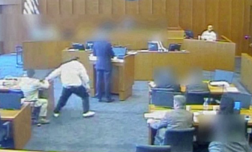 <em>The gang member was seen grabbing a pen before attacking the witness (Grab)</em>