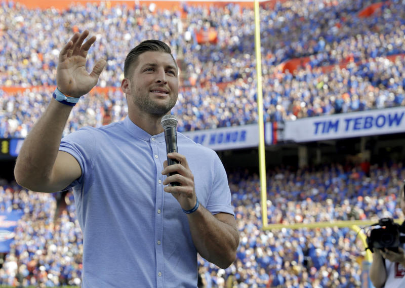 Former Florida football player Tim Tebow speaks to fans after he was inducted in the Ring of Honor at Florida Field during the first half of an NCAA college football game against LSU, Saturday, Oct. 6, 2018, in Gainesville, Fla. (AP Photo/John Raoux)