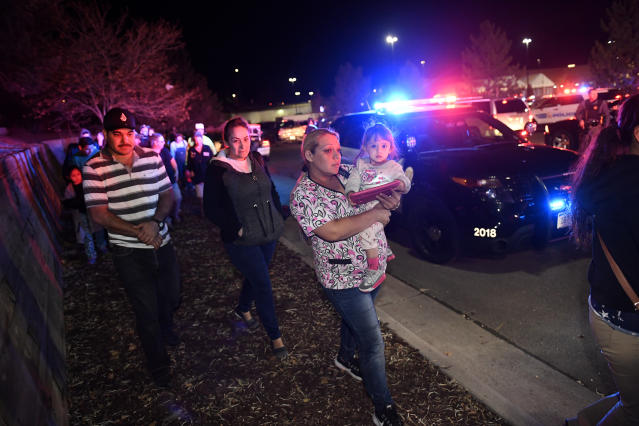 <p>Walmart employees and customers head away from the scene outside of the Walmart store where a shooting occurred inside the store at 9901 Grant Street on Nov. 1, 2017 in Thornton, Colo. (Photo: Helen H. Richardson/The Denver Post via Getty Images) </p>