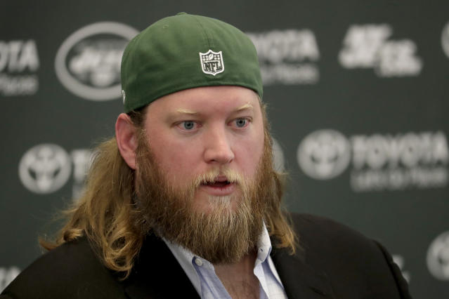 New York Jets center Nick Mangold officially retires during an NFL football news conference, Tuesday, April 24, 2018, in Florham Park, N.J. Mangold announced his retirement a week earlier in a post on Twitter. He was selected to seven Pro Bowls and was twice a first-team All-Pro during his 11-year career. (AP Photo/Julio Cortez)