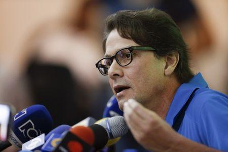 FILE PHOTO - Lorenzo Mendoza, president of Venezuela's largest private food production company Empresas Polar, speaks during a news conference in Caracas