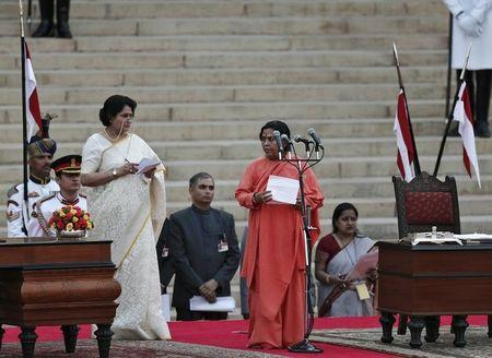Bharti is administered oath of office by India's President Mukherjee as a cabinet minister at the presidential palace in New Delhi