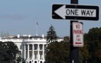 FILE PHOTO: A 'One Way' street sign is seen in front of the White House in Washington