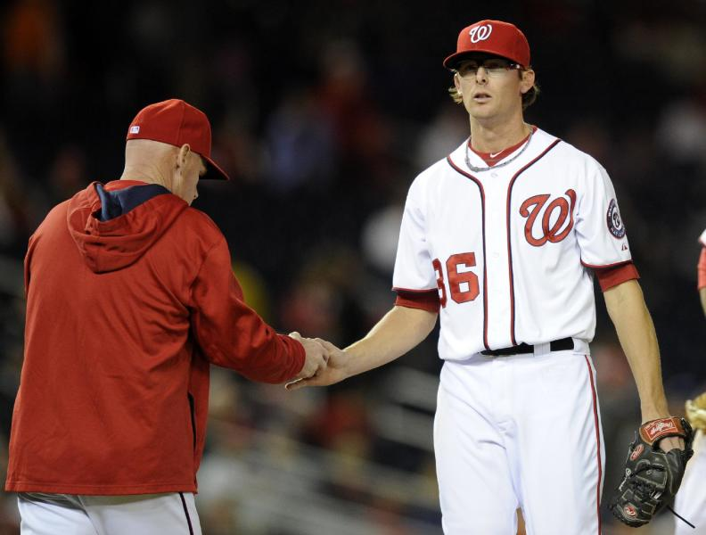 Washington Nationals relief pitcher Tyler Clippard (36) is pulled from the game by Washington Nationals manager Matt Williams, left, during the eighth inning of a baseball game against the Los Angeles Angels, Monday, April 21, 2014, in Washington. The Angels won 4-2. (AP Photo/Nick Wass)