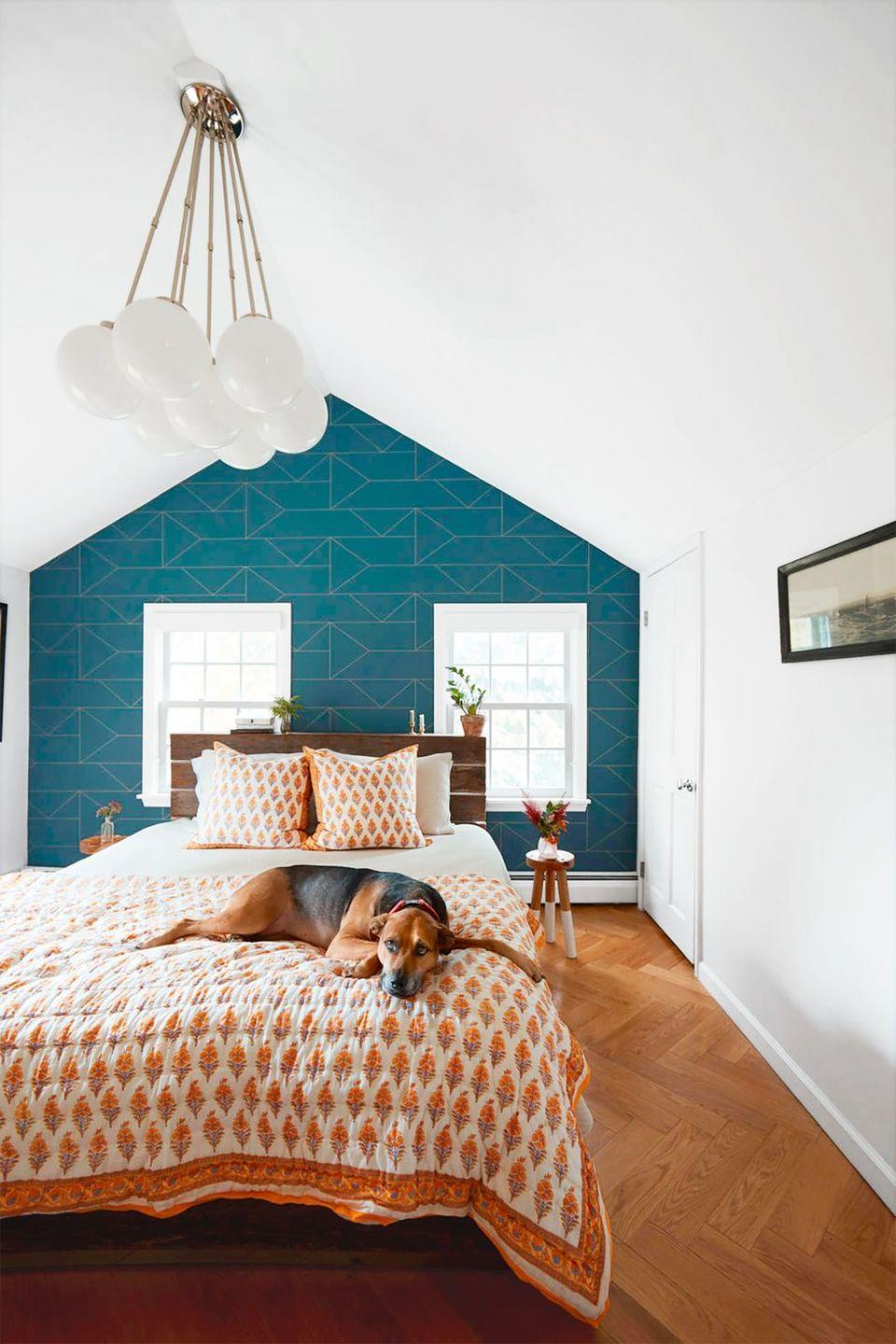 """<p>Rely on graphic wallpaper, such as this teal geometric design, to introduce contrast into a white bedroom. <br></p><p><b>RELATED: </b><a href=""""https://www.goodhousekeeping.com/home/decorating-ideas/g35993483/best-removable-temporary-wallpapers/"""" rel=""""nofollow noopener"""" target=""""_blank"""" data-ylk=""""slk:15 Removable Wallpapers That Will Temporarily Transform Your Space"""" class=""""link rapid-noclick-resp"""">15 Removable Wallpapers That Will Temporarily Transform Your Space</a></p>"""