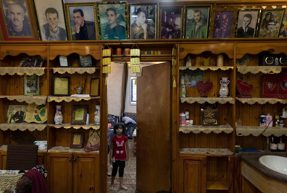 Palestinians Grieving Family (Copyright 2021 The Associated Press. All rights reserved)