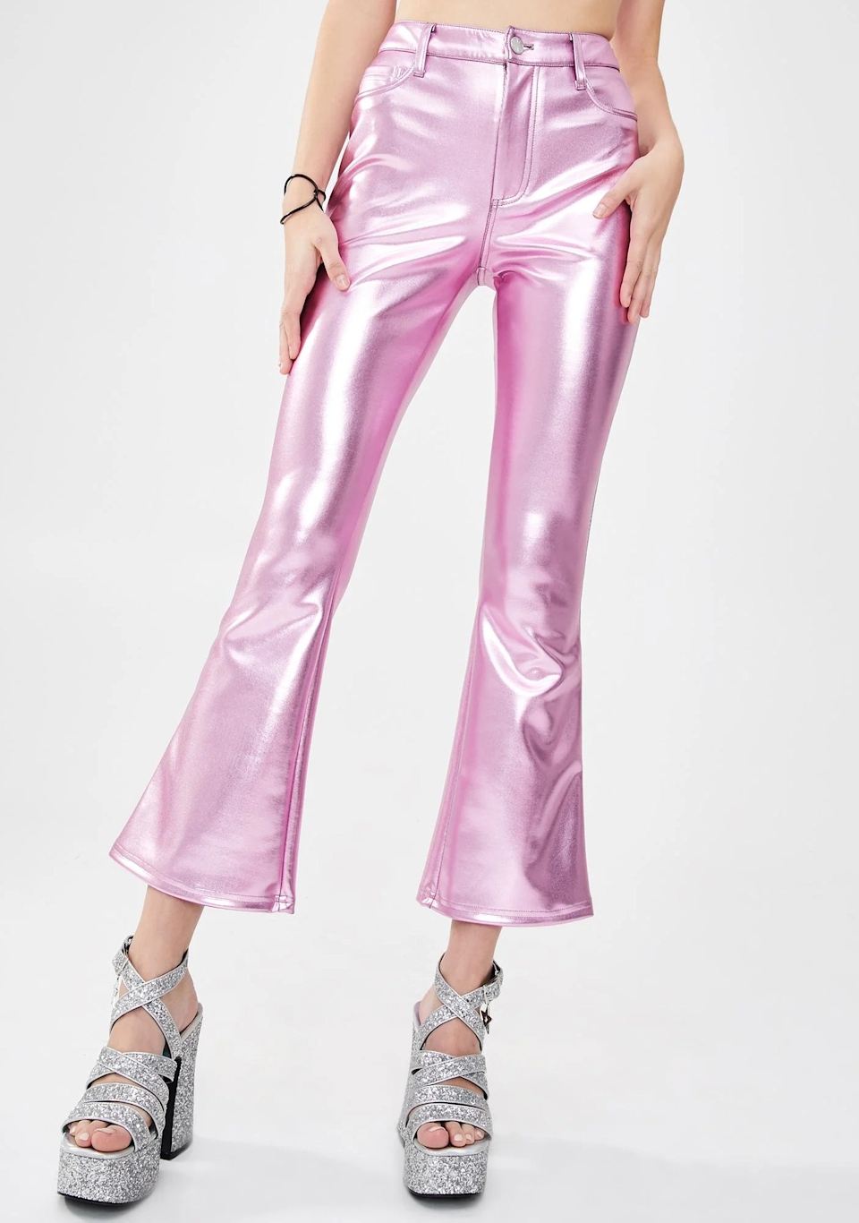 "<br><br><strong>dELiA*s by Dolls Kill</strong> Metallic Flare Pants, $, available at <a href=""https://go.skimresources.com/?id=30283X879131&url=https%3A%2F%2Fwww.dollskill.com%2Fdelias-metallic-flare-pants-pink.html"" rel=""nofollow noopener"" target=""_blank"" data-ylk=""slk:Delia's"" class=""link rapid-noclick-resp"">Delia's</a>"