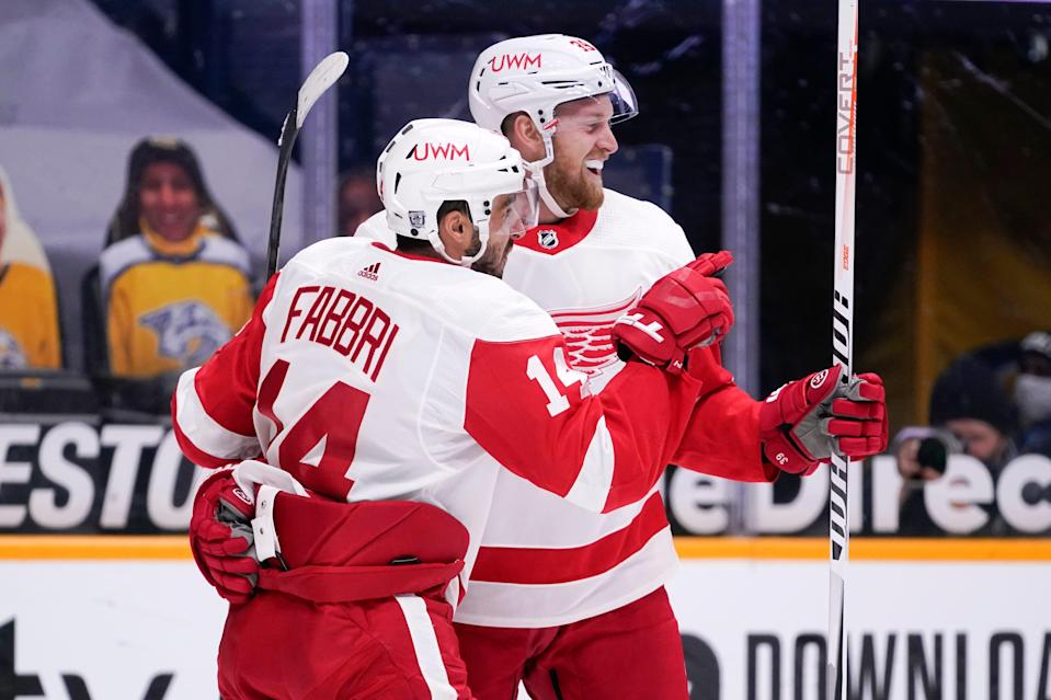 Detroit Red Wings center Robby Fabbri (14) celebrates with Anthony Mantha (39) after Fabbri scored a goal against the Nashville Predators in the first period Saturday, Feb. 13, 2021, in Nashville, Tenn.