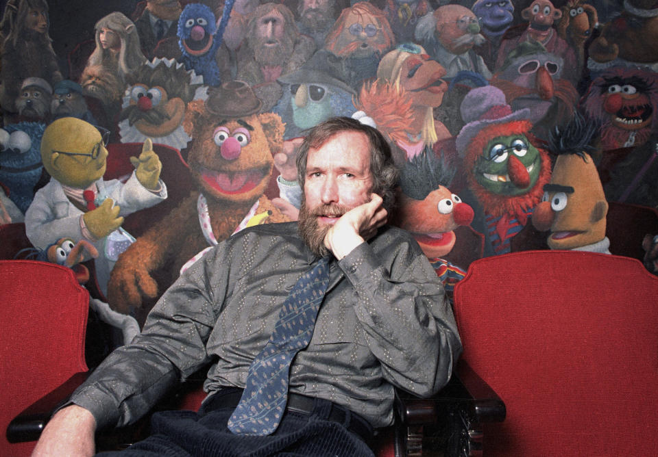 FILE - In this Dec. 30, 1985 file photo, creator of the Muppets Jim Henson poses in his 69th Street office in New York City. The American creator of the Muppets was honored Tuesday, Sept, 7, 2021 in Britain with a blue plaque at his former home in north London, which he bought after 'The Muppet Show' was commissioned for British television — 50 Downshire Hill in Hampstead in north London to be precise. (AP Photo/Burnett, FIle)