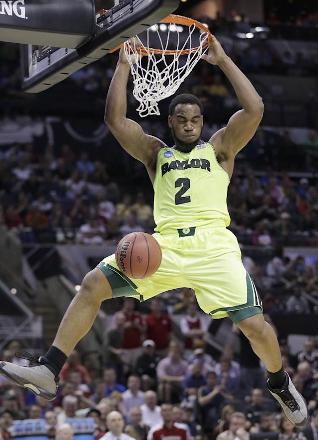 Baylor's Rico Gathers (2) scores against Nebraska during the first half of a second-round game in the NCAA college basketball tournament Friday, March 21, 2014, in San Antonio. (AP Photo/Eric Gay)