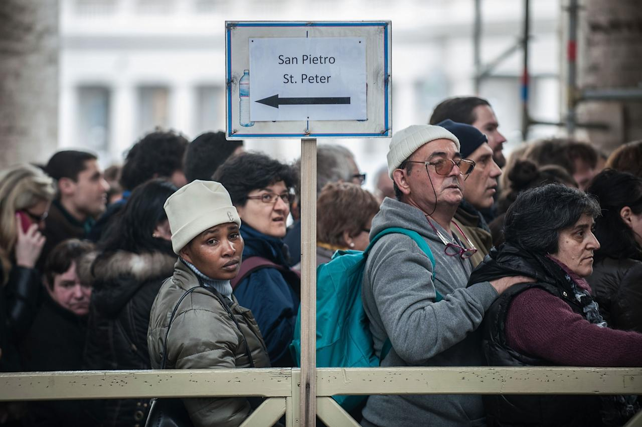 VATICAN CITY, VATICAN - FEBRUARY 17:  Faithful in queue to attend Pope Benedict XVI Angelus Blessing at St. Peter's Square on February 17, 2013 in Vatican City, Vatican. The Pontiff will hold his last weekly public audience on February 27 at St Peter's Square after announcing his resignation last week.  (Photo by Giorgio Cosulich/Getty Images)