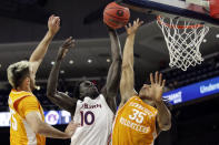 Auburn forward JT Thor (10) puts up a shot as Tennessee guard Yves Pons (35) and Tennessee guard Santiago Vescovi (25) try and block during the first half of an NCAA basketball game Saturday, Feb. 27, 2021, in Auburn, Ala. (AP Photo/Butch Dill)