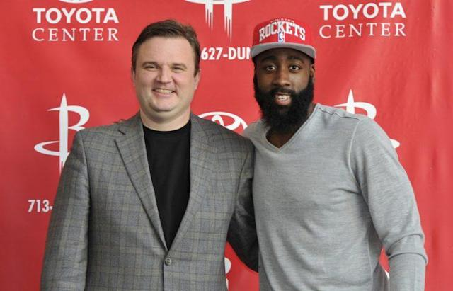 Rockets GM Daryl Morey poses with James Harden. (Getty)
