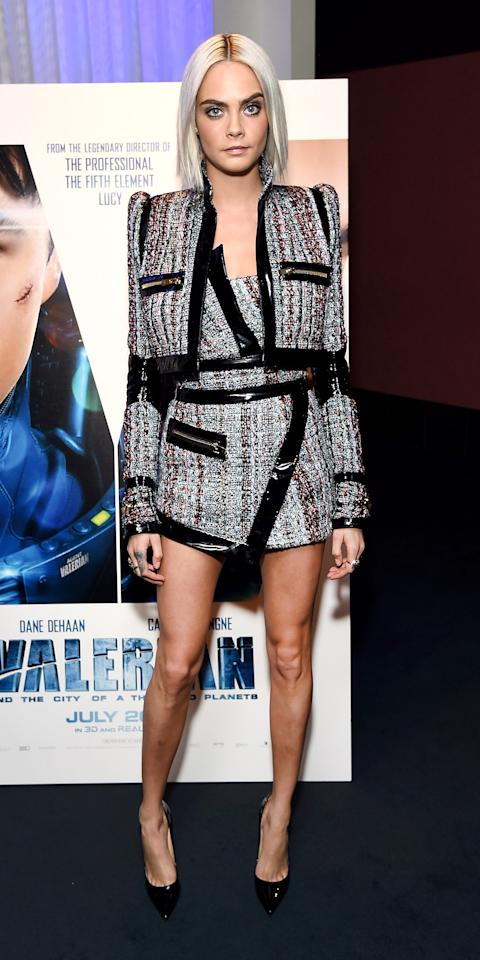 <p>Cara Delevingne reminded us she's the ultimate cool girl in this boucle mini dress and matching cropped jacket with patent leather trim and zippers galore. The model-actress kept it femme and sexy with high shine patent leather pumps.</p>