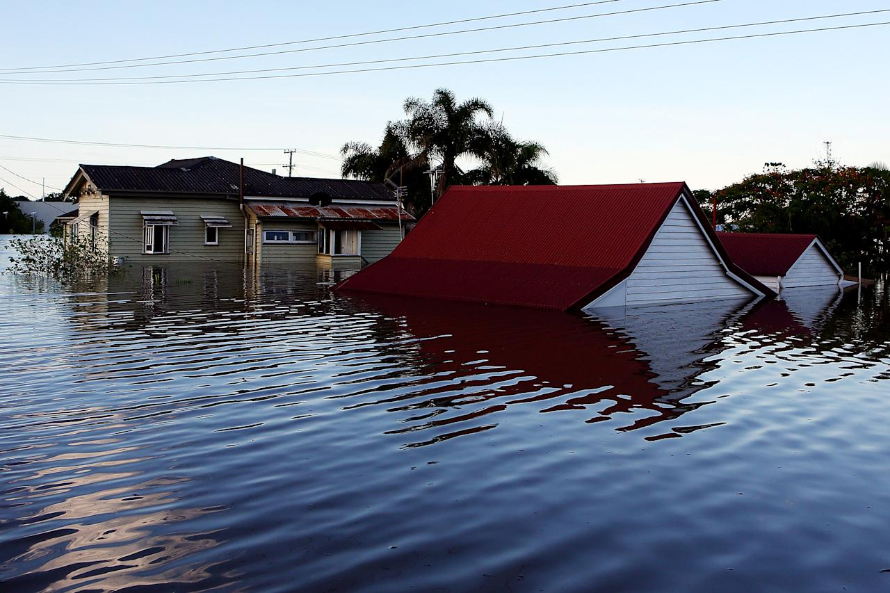 BUNDABERG, AUSTRALIA - JANUARY 29: Houses are flooded as parts of southern Queensland experiences record flooding in the wake of Tropical Cyclone Oswald on January 29, 2013 in Bundaberg, Australia.Four deaths have been confirmed and thousands have been evacuated in Bundaberg as the city faces it's worst flood disaster in history. Rescue and evacuation missions continue today as emergency services prepare to move patients from Bundaberg Hospital to Brisbane amid fears the hospital could lose power. (Photo by Chris Hyde/Getty Images)