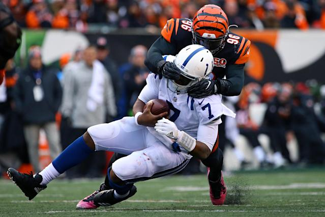 <p>Cincinnati Bengals defensive end Carlos Dunlap (96) tackles Indianapolis Colts quarterback Jacoby Brissett (7) in the second half at Paul Brown Stadium. Mandatory Credit: Aaron Doster-USA TODAY Sports </p>