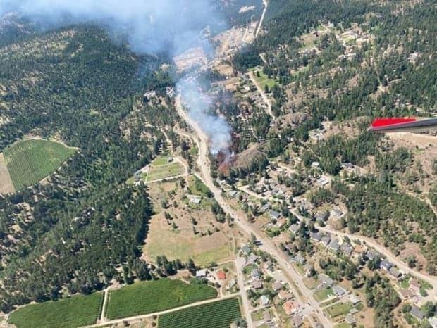 An image of the McCall Creek wildfire burning four kilometres southwest of Peachland on June 26, 2021. (BC Wildfire Service - image credit)