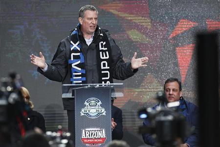 Blasio speaks as he attends the Super Bowl Hand-Off Ceremony at the Boulevard fan zone ahead of Super Bowl XLVIII in New York