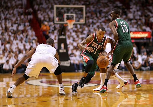 MIAMI, FL - APRIL 21: Monta Ellis #11 of the Milwaukee Bucks drives on Dwyane Wade #3 of the Miami Heat during Game 1 of the Eastern Conference Quarterfinals of the 2013 NBA Playoffs at American Airlines Arena on April 21, 2013 in Miami, Florida. NOTE TO USER: User expressly acknowledges and agrees that, by downloading and or using this photograph, User is consenting to the terms and conditions of the Getty Images License Agreement. (Photo by Mike Ehrmann/Getty Images)
