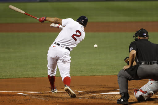 Boston Red Sox's Xander Bogaerts hits an RBI single against the Philadelphia Phillies during the first inning of a baseball game Tuesday, Aug. 18, 2020, at Fenway Park in Boston. (AP Photo/Winslow Townson)