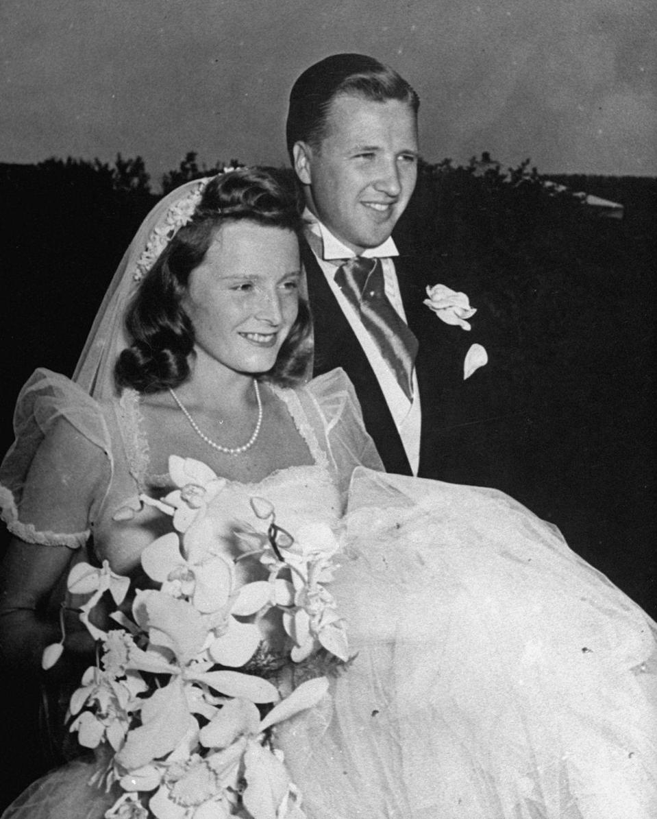 """<p>This 1940 wedding was a HUGE deal—in fact, a hilariously old-time-y video about it can be found on <a href=""""https://www.youtube.com/watch?v=xLoEvkEMZCk"""" rel=""""nofollow noopener"""" target=""""_blank"""" data-ylk=""""slk:YouTube"""" class=""""link rapid-noclick-resp"""">YouTube</a>. </p><p>Henry Ford II and Anne McDonnell were married in Long Island, and the church was swarming with hundreds of uninvited guests hoping for a glimpse of the bride and groom. Anne's dress is ever-so lovely, with sheer cap sleeves and a giant skirt.<br><br></p>"""