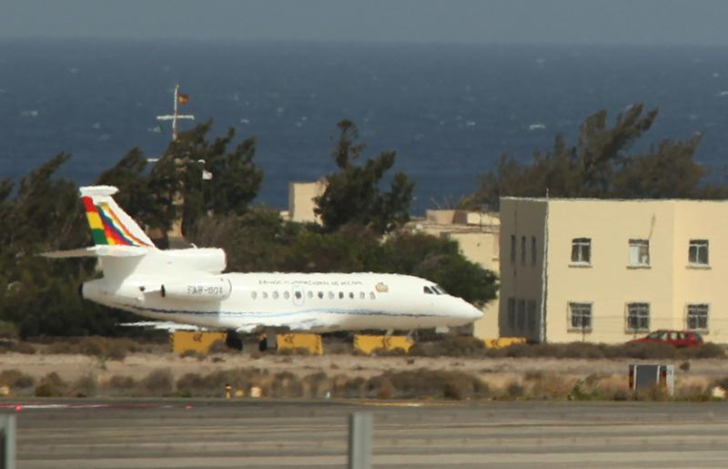 The Bolivian presidential plane believed to be carrying President Evo Morales leaves the Gran Canaria airport in Las Palmas de Gran Canaria island, Spain Wednesday June 3, 2013. Bolivia's president left Europe for home on Wednesday amid diplomatic drama after his flight was rerouted and delayed overnight in Austria, allegedly because of suspicion he was trying to spirit NSA leaker Edward Snowden to Latin America. The plane was rerouted to Vienna on Tuesday night, adding a new twist to the international uproar over Snowden's revelations of widespread U.S. surveillance. (AP Photo/Andres Gutierrez)