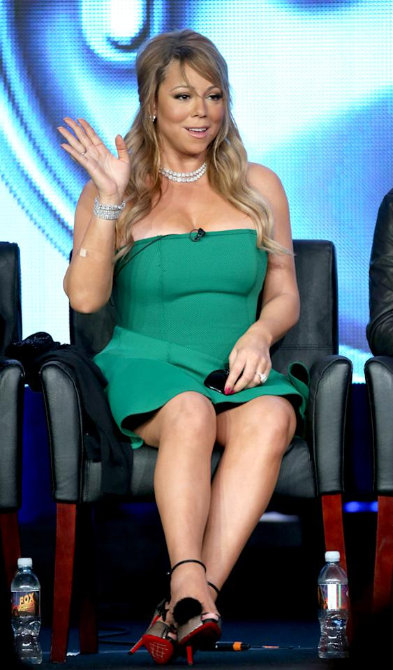 "PASADENA, CA - JANUARY 08:  Judge Mariah Carey of ""American Idol"" speaks onstage during the FOX portion of the 2013 Winter TCA Tour at Langham Hotel on January 8, 2013 in Pasadena, California.  (Photo by Frederick M. Brown/Getty Images)"