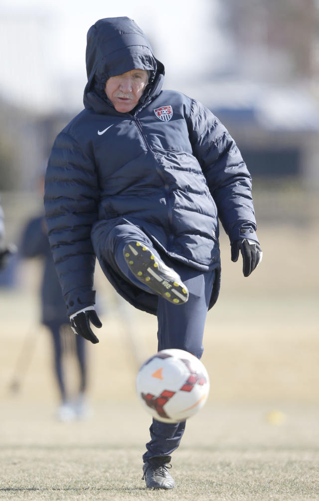 "In this photo taken on Tuesday, Jan. 28, 2014, U.S. women's soccer head coach Tom Sermanni kicks a ball during team practice in Frisco, Texas. Sermanni found out what a unique job it is to be coach of the top-ranked U.S. women's soccer team. Now he's headed into his second year, one in which he is looking for performance and results into World Cup qualifying after a year of what he called ""assessment and opportunity.'' (AP Photo/LM Otero,Pool)"