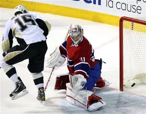 Montreal Canadiens goalie Carey Price (31) makes a save against Pittsburgh Penguins center Dustin Jeffrey (15) during the first period of an NHL hockey game Tuesday, Feb. 7, 2012, in Montreal. (AP Photo/The Canadian Press, Ryan Remiorz)
