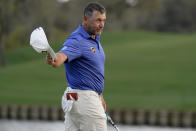 Lee Westwood, of England, celebrates after making a putt on the 18th hole during the third round of The Players Championship golf tournament Saturday, March 13, 2021, in Ponte Vedra Beach, Fla. (AP Photo/Gerald Herbert)