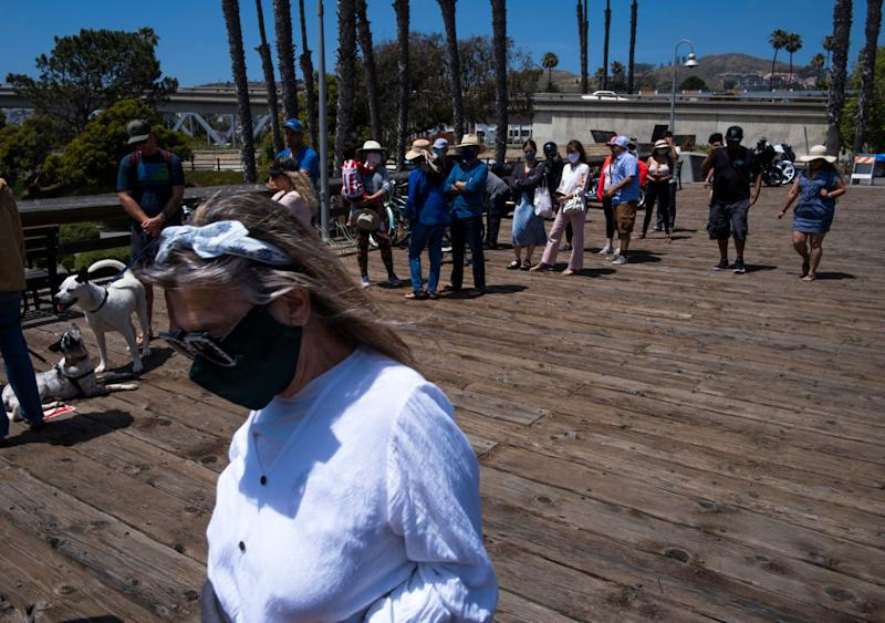 People enjoy the less restricted beachfront over Memorial Weekend in California. Source: Getty Images
