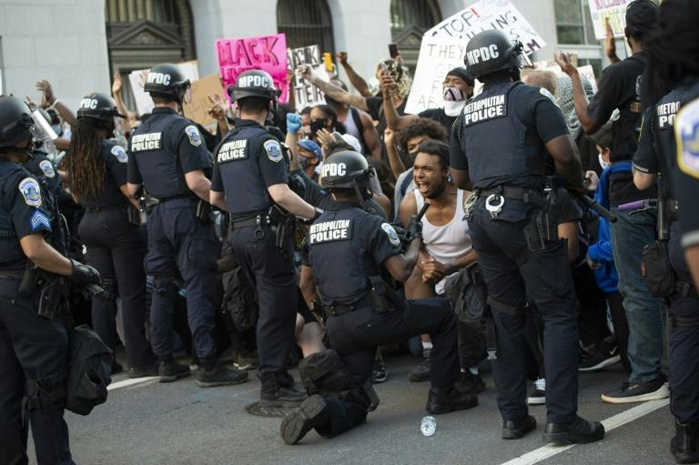 Demonstrators are seen in Washington, DC in May 2020