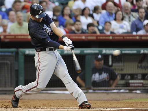 Atlanta Braves' Tyler Pastornicky swings for an RBI single against the Houston Astros in the second inning of a baseball game Monday, April 9, 2012, in Houston. (AP Photo/Pat Sullivan)