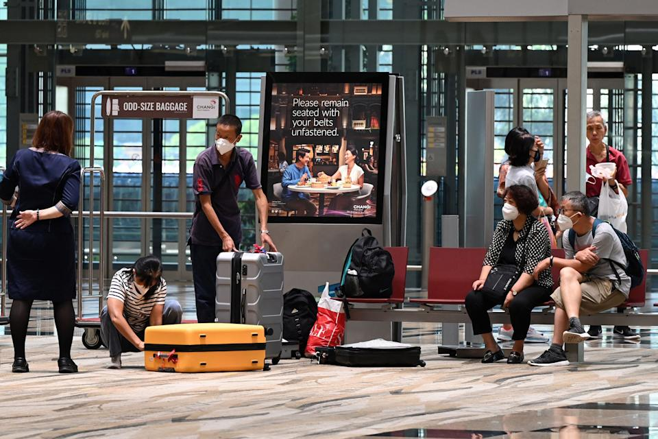 Passengers prepare to check-in their luggage at Changi International Airport in Singapore. Source: Getty