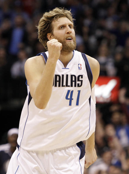 Dallas Mavericks forward Dirk Nowitzki (41) celebrates scoring two points during the second half of an NBA basketball game against the Los Angeles Clippers, Tuesday, March 26, 2013, in Dallas. Dallas won 109-102 in overtime. (AP Photo/Brandon Wade)