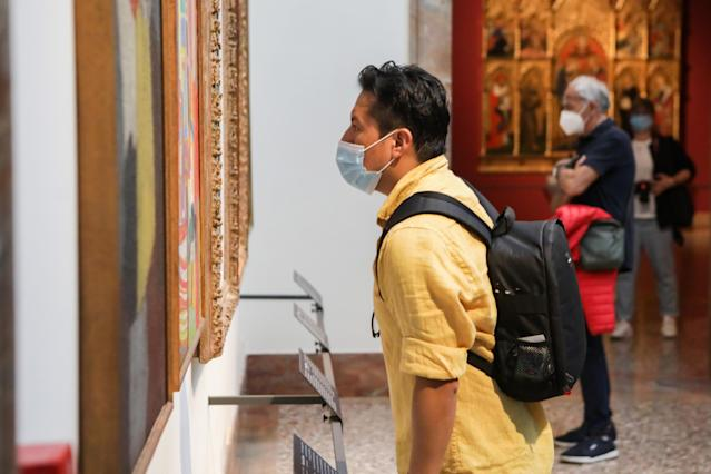 A man wears a mask in a gallery in Milan. (Getty Images)