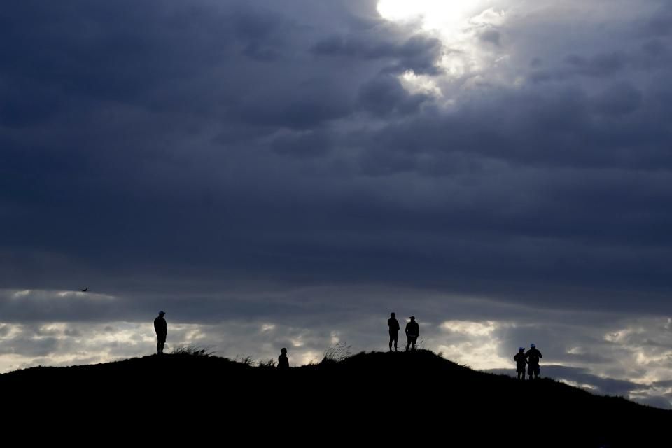 Fans overlook the 14th green during a four-ball match the Ryder Cup at the Whistling Straits Golf Course Friday, Sept. 24, 2021, in Sheboygan, Wis. (AP Photo/Charlie Neibergall)