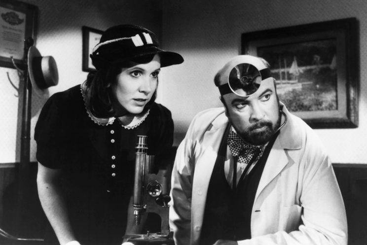 <p>Fisher appeared in a sci-fi spoof movie in a segment called <em>Reckless Youth</em> with Paul Bartel in 1987. (Photo: Everett Collection)</p>