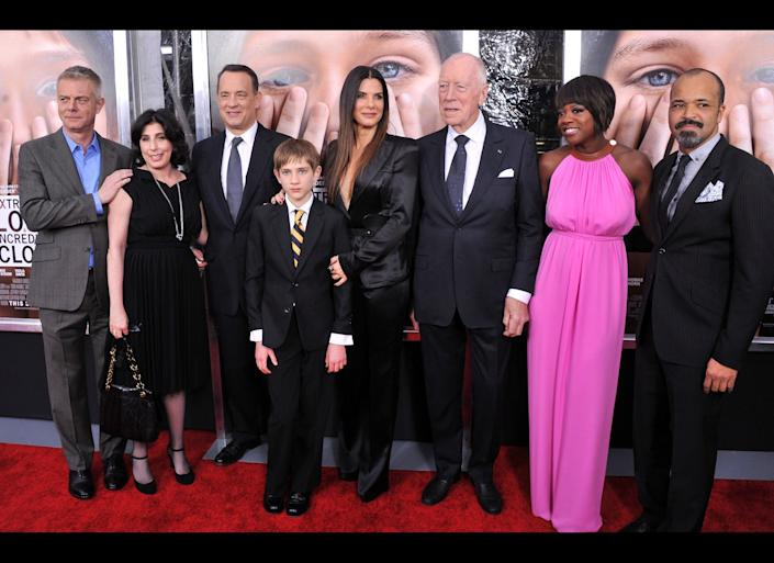 NEW YORK, NY - DECEMBER 15: (L-R) Director Stephen Daldry, President of worldwide marketing for Warner Bros. Sue Kroll, actor Tom Hanks, actor Thomas Horn, actress Sandra Bullock, actor Max Von Sydow, actress Viola Davis, and actor Jeffrey Wright attend the 'Extremely Loud & Incredibly Close' New York premiere at the Ziegfeld Theater on December 15, 2011 in New York City. (Photo by Stephen Lovekin/Getty Images)