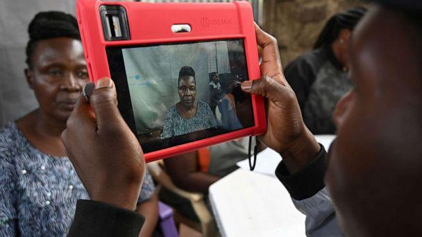PHOTO: A Kenyan woman looks at a biometric camera prior to register for the Huduma Namba, May, 17, 2019, in Nairobi. (Simon Maina/AFP/Getty Images)