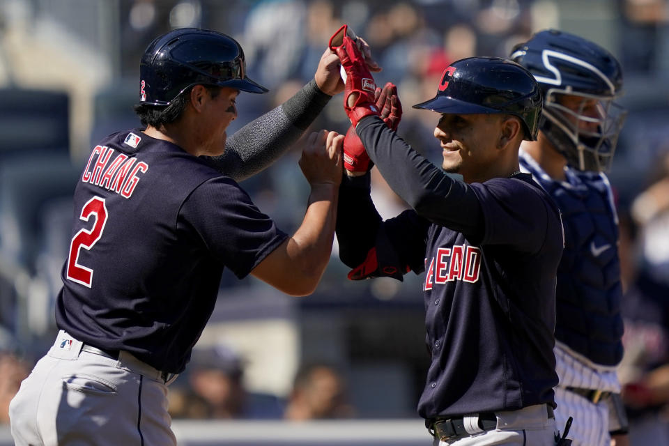 Cleveland Indians' Andres Gimenez, right, celebrates with Yu Chang, left, after hitting a three-run home run off New York Yankees relief pitcher Albert Abreu in the fifth inning of a baseball game, Saturday, Sept. 18, 2021, in New York. (AP Photo/John Minchillo)