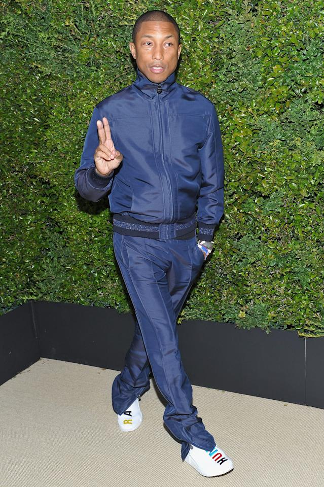 <p>in a navy silk jacket and pants from Chanel's fall 2017/18 Act1 ready-to-wear collection.</p>